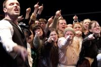 Photo of a production featuring a jeering crowd