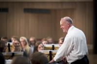 Alan Broadbent conducts students in an orchestra
