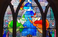 Stained Glass window depicting Sleeping Beauty's Fairy godmothers