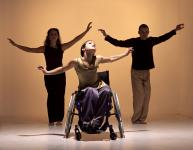 Photo of three dancers - one in a wheelchair