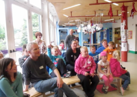 Photo of families with children involved in workshop