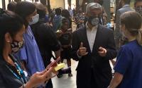 photo of Sadiq Khan speaking to NHS workers