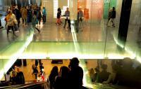 Visitors on an escalator at London's Tate Modern