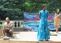 Photo of three actors on stage