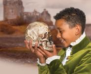 Photo of boy holding a skull