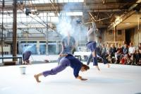 Photo of dancers in industrial setting