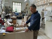 Photo of artist Mark Richard in his studio