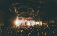 A band performing on stage at a music venue