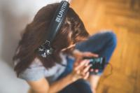 Photo of woman wearing headphones
