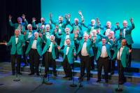 A male voice choir wearing turquoise jackets