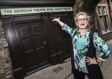 Aimee Shields outside the main door at Richmond's Georgian Theatre Royal