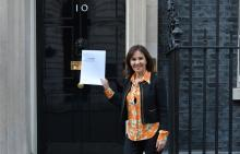 Photo of Arlene Phillips outside Number 10 with letter
