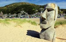 Photo of head sculpture on the beach