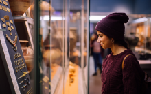 Woman looking at artefacts in the British Museum