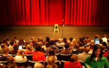 an audience waiting for a show to start