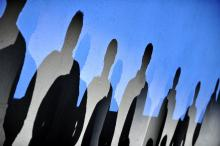 Photo of human shapes against blue sky