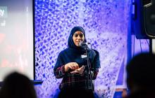 Photo of Imrana speaking at the Power of Community symposium
