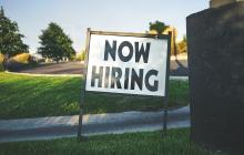 'Now Hiring' signpost