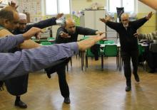 Photo of men dancing