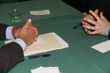 Image of hands of interviewer and interviewee