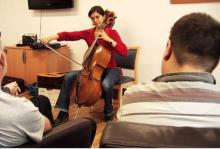 Photo of cellist performing for patients
