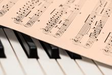 Image of piano keys and music