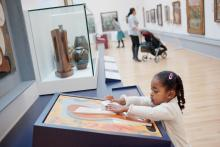Young girl looking at a museum display