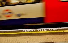 Underground station platform showing words 'mind the gap'