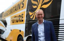 Photo of Tim Farron in front of campaign bus