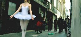 Photo of ballet dancer in grimy street