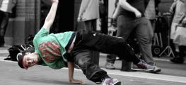 Photo of break dancer performing on street