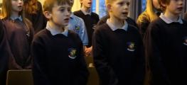 Photo of school children singing