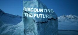 picture of an iceberg with the words 'discounting the future' projected on it