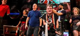 A group of Graeae performers on stage in a production of Reasons to be Cheerful in 2017