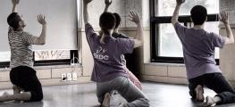 Photo of three dancers rehearsing