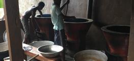 Photo of children stirring big pots