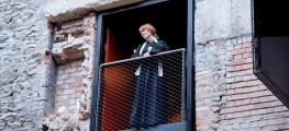 Photo of actress looking down from balcony
