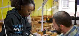 Photo of a girl learning on a craft apprenticeship