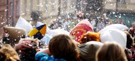 Photo of people in street pillow fight