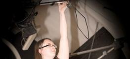 Photo of woman setting camera
