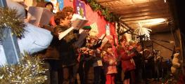 A school choir sings at a Christmas event