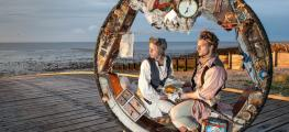 Photo of two people sat inside giant wheel