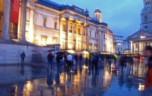 A photo of people in the rain outside London's National Gallery