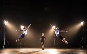 three ballet dancers performing on stage