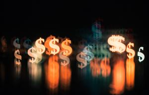 Image of multiple dollar signs in on a black background
