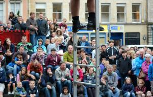 a crowd watching a street performance in Edinburgh