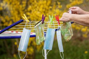 face masks drying on a washing line