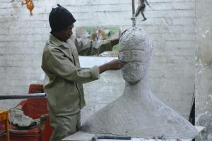 Man working on his sculpture