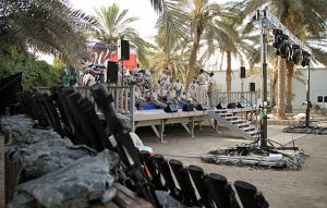 US troops performing on an outdoor stage at an undisclosed location