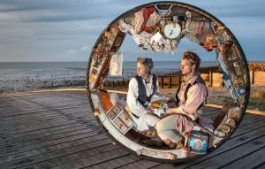 Photo of two performers in a wheel
